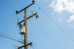 Power transmission line with blue sky background Stock Photo