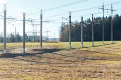 Power transmission line. On high voltage post stock photography