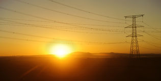 Power transmission line in sunrise Royalty Free Stock Photography