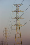 Power Transmission Line with Yellow sky Stock Photo