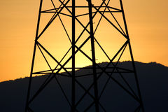 Power Transmission Line with Yellow sky Stock Photos