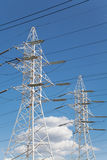 Power transmission lines against blue sky Stock Photos