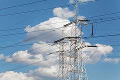 Power transmission lines against blue sky Royalty Free Stock Images