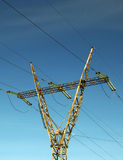 Power transmission pole with sky as background. Power transmission pole with high energy cables standing with blue sky as background Stock Photos
