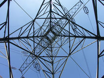 Power transmission pylon - looking up. Power transmission pylon royalty free stock photography