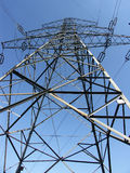 Power transmission pylon - looking up. Hight voltage tower royalty free stock photos