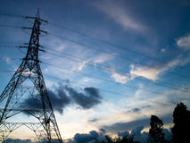 Power Transmission and Supply. High voltage electricity pylon builds on countryside Stock Photos