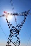 Power transmission tower. On background blue sky royalty free stock image