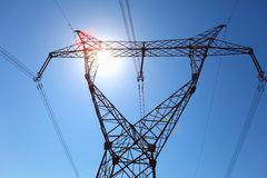 Power transmission tower. On background blue sky royalty free stock photo