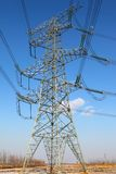Power transmission tower. On background blue sky stock photos