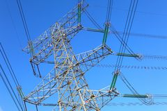 Power transmission tower. On background blue sky royalty free stock images