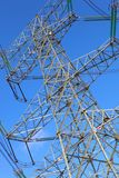 Power transmission tower. On background blue sky royalty free stock photos