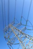 Power transmission tower. On background blue sky stock photography