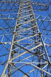 Power transmission tower. On background blue sky stock image