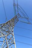 Power transmission tower. On background blue sky royalty free stock photography