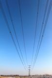 Power transmission tower. On background blue sky stock photo