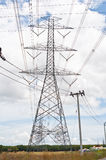Power transmission tower. Electrical transmission tower with cloud and sky royalty free stock photo