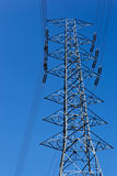 Power transmission tower. And blue sky stock images