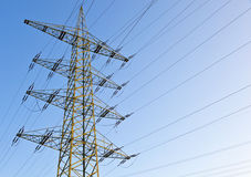 Power transmission tower. Under blue sky royalty free stock photography