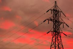 Power Transmission Tower. Against a blue and pink sunset glowing in the background stock photos