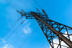 Power transmission tower against the blue sky. Alone pole power lines stock photos