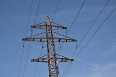 Power transmission tower on background of blue sky stock images