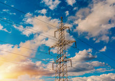 Power transmission tower and the beauty of the sunset sky. Power transmission tower and the beauty of the sunset sky royalty free stock images