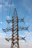 Power transmission tower with cables against the sky. Stock Images