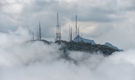 Power transmission tower in the fog at the mountains. stock photo