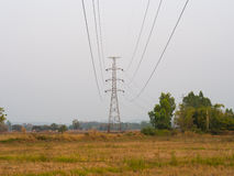 Power transmission tower. The image of power transmission tower in the field stock photography