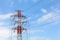 Power transmission tower. Industrial photo of power transmission tower and nice blue sky stock images