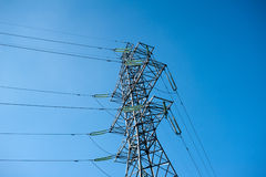 Power transmission tower. Over a blue sky stock image