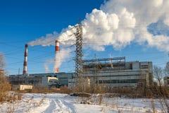 Power transmission tower on sky. Power transmission tower on background smoking chimneys stock photo