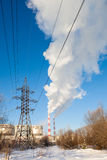 Power transmission tower on sky. Power transmission tower on background smoking chimneys stock photography