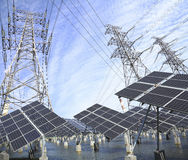 Power transmission tower and Solar panel in the green Stock Photo