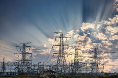 Power transmission tower and sun rays Royalty Free Stock Images