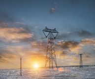 Power transmission tower on plateau. Power transmission tower on tibetan plateau in sunset Royalty Free Stock Photography