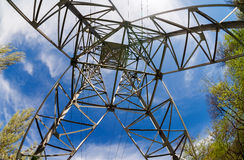 Power transmission tower. Upward view of the structure under power transmission tower royalty free stock photography