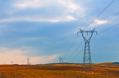 Power transmission towers. Picture is of power transmission towers reflecting in the morning royalty free stock photography