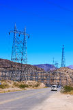 Power Transmission Towers by Highway Royalty Free Stock Photography
