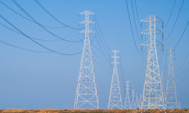Power. Traveling down the lines to fuel the world we live in stock photography