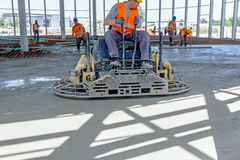 Power trowel machine for finishing surface concrete leveling aft Stock Images