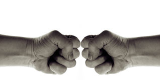 Power war conflict. Two fists punching each other, a conflict, trouble, disagreement or war Royalty Free Stock Photos