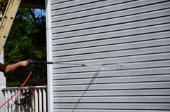 Power washing. Annual chore of cleaning house siding stock photography