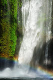 Power of water (waterfall and rainbow). Waterfall and rainbow in sunny day Stock Image