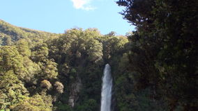 Power water of waterfall in a rocky coast and mountains New Zealand. stock video