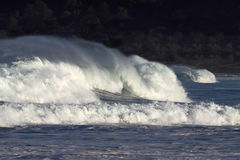 The power of waves. Nothing beats the power of tropical waves spraying in the wind stock photo