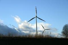 Power of wind. Wind powerplants on a field near Vienna Stock Images