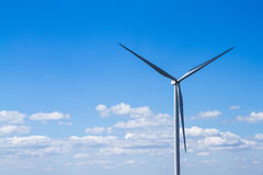 Power of wind turbine generating electricity clean energy with c. Loud background on the blue sky.Global ecology.Clean energy concept save the world stock image
