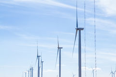 Power of wind turbine generating electricity clean energy with c. Loud background on the blue sky.Global ecology.Clean energy concept save the world stock photo